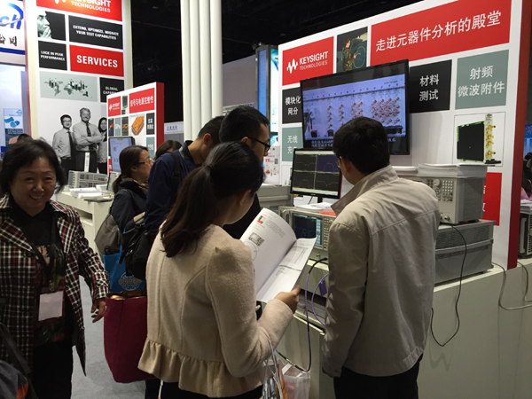 The Keysight booth drew many to watch equipment demos.